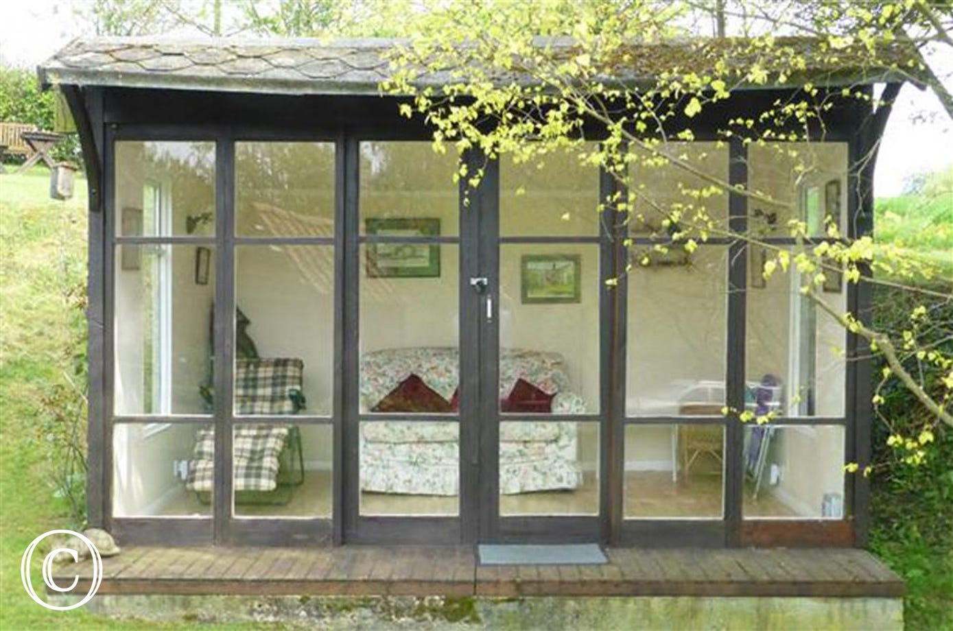Enjoy sitting in this summer house and enjoying the generous gardens and grounds from within.