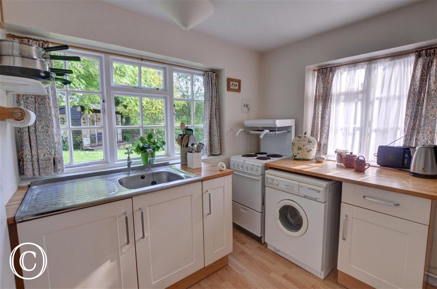 Enjoy cooking in this modest but functional kitchen whilst staying at Apple Tree Cottage.