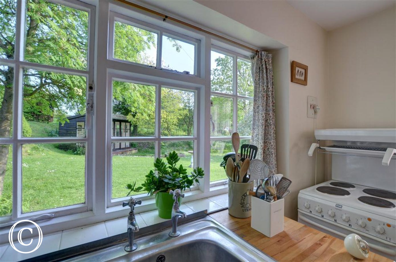 Enjoy the sights and smells from this kitchen window whilst washing up or cooking.