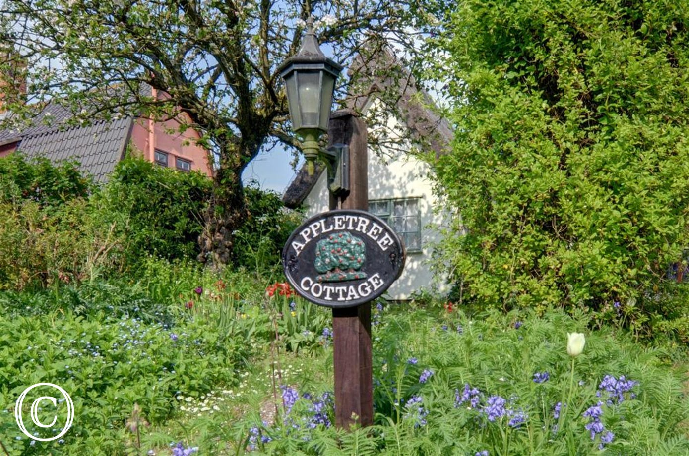 This pretty name plate is situated within the car parking area and guides to way to the property.