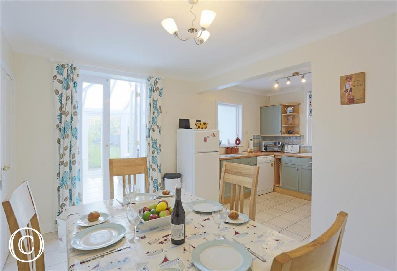 A bright dining/kitchen area for you all to eat together with adjoining conservatory.