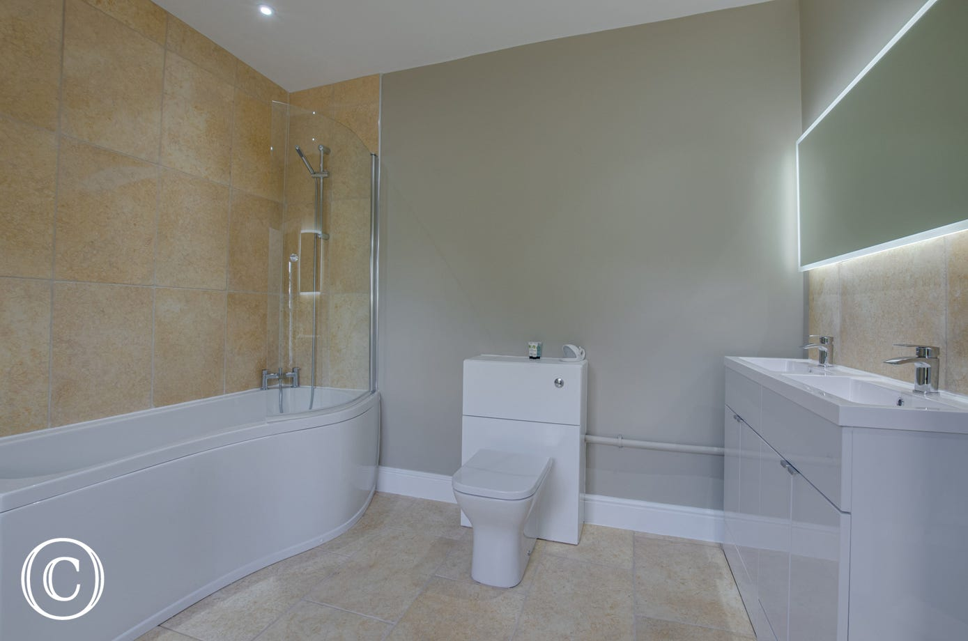 Bedroom 6 Ensuite with bath, overhead shower, two washbasins & wc