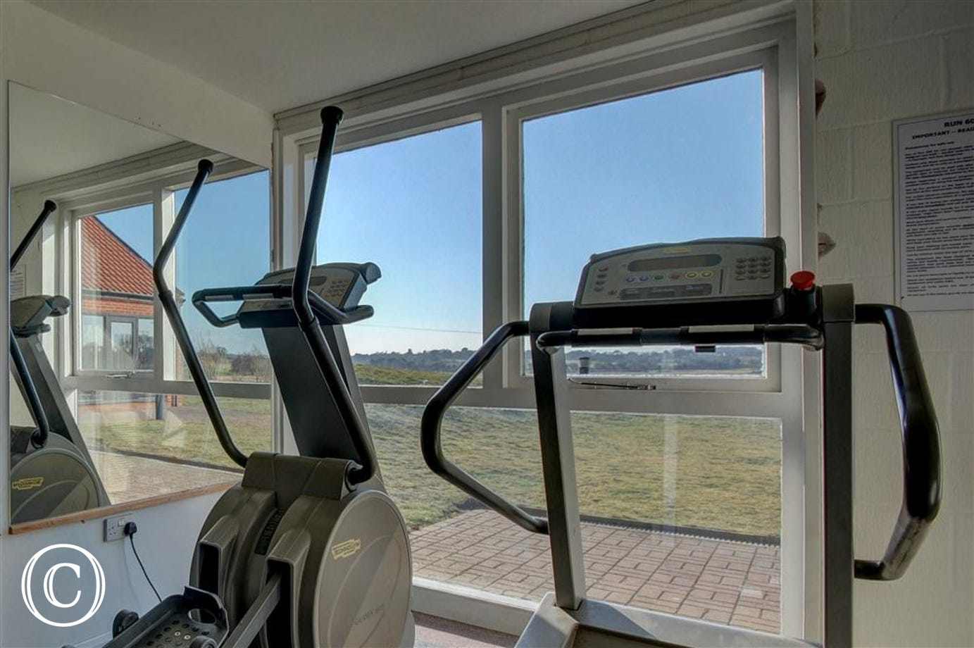 Go for a slow walk come rain or shine on this treadmill in the gym within the Leisure Hall with the fields as a view.