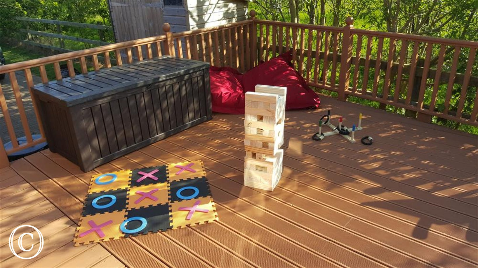 External decking with garden games
