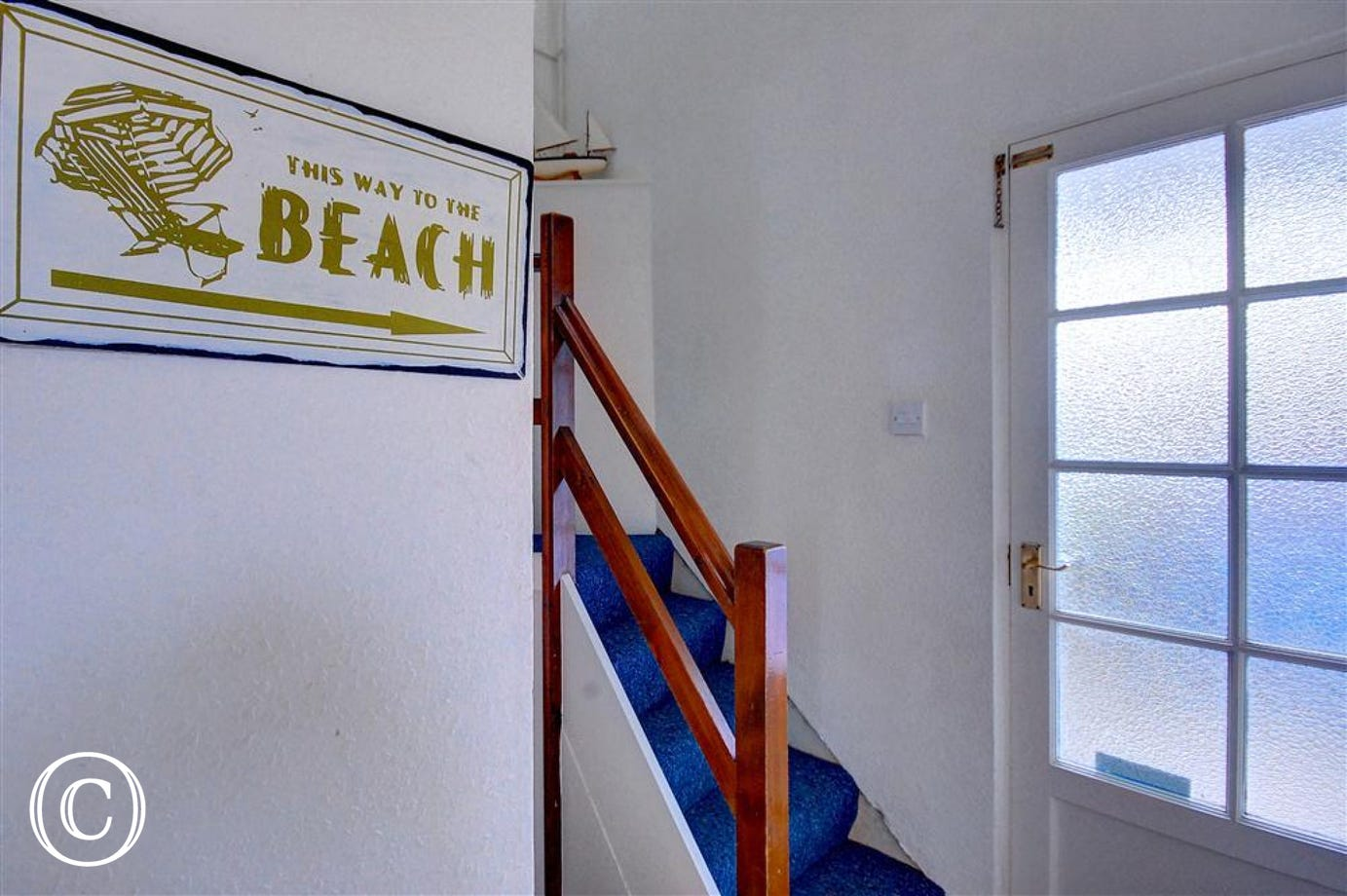 This hallway is bright and spacious and guides you to the beach on entry, the steps up to the bedroom from this area do twist up and round to the left but are carpeted and easy to use.