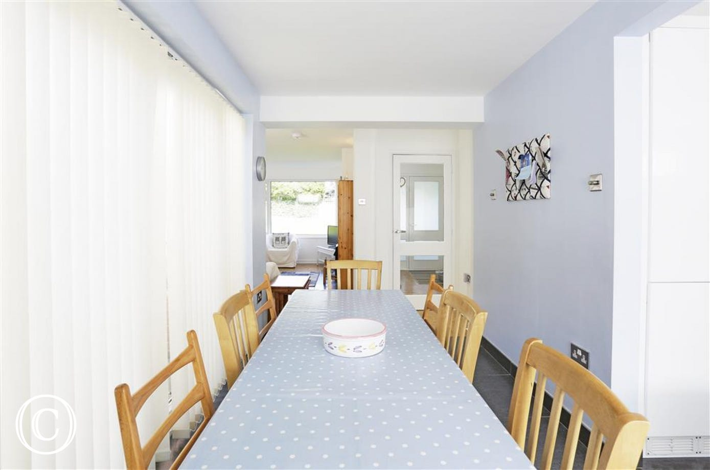 Gather in this open dining area with bright windows and access into the gardens areas.