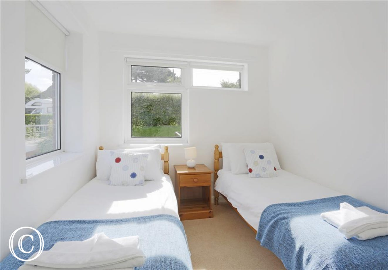This twin bedroom has 2'6 single beds but sadly no balcony. It is decorated in a blue and white colour scheme.