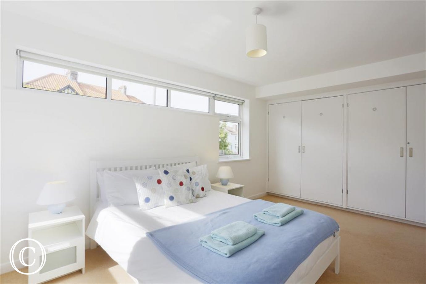 Two of you can relax in this main king size bedded room with plenty of windows for light and views into the garden below