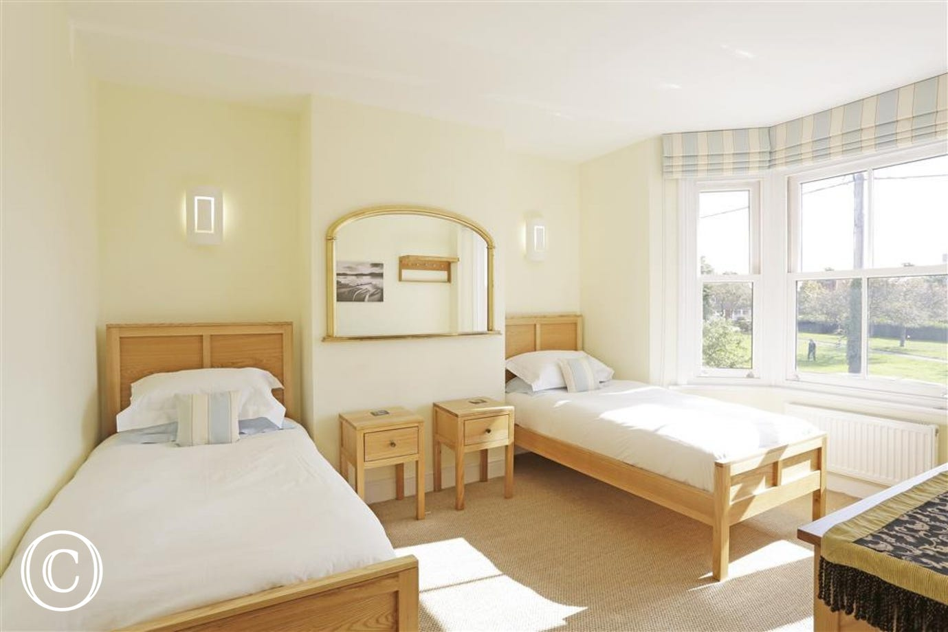 This twin bedded room is situated at the front of the property and has a good view of the church green and the light house in the distance.