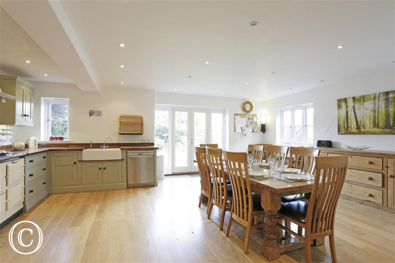 The open plan kitchen and dining area is light and airy with a view of the garden and provides access to the wet room.