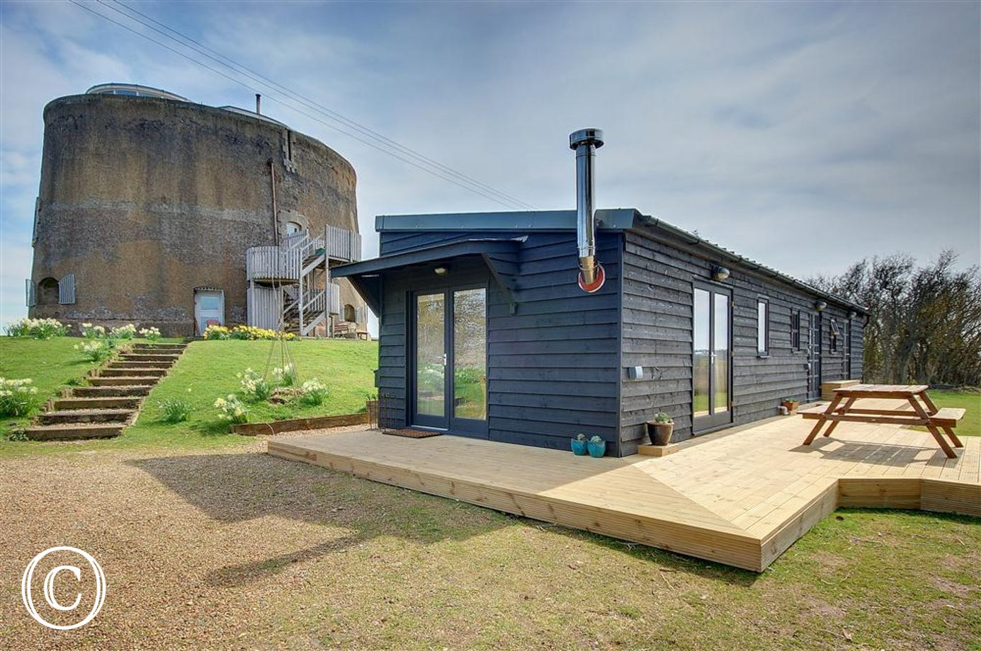 The Martello Boathouse offers modern accommodation in this fabulous conversion.