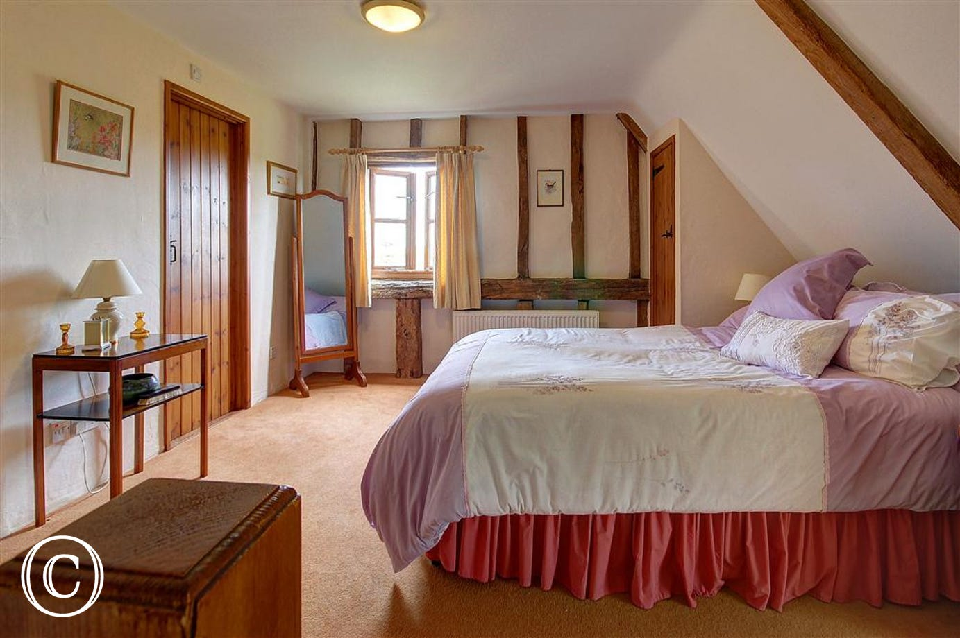 A large double bedroom with ample space for relaxation and sleeping.