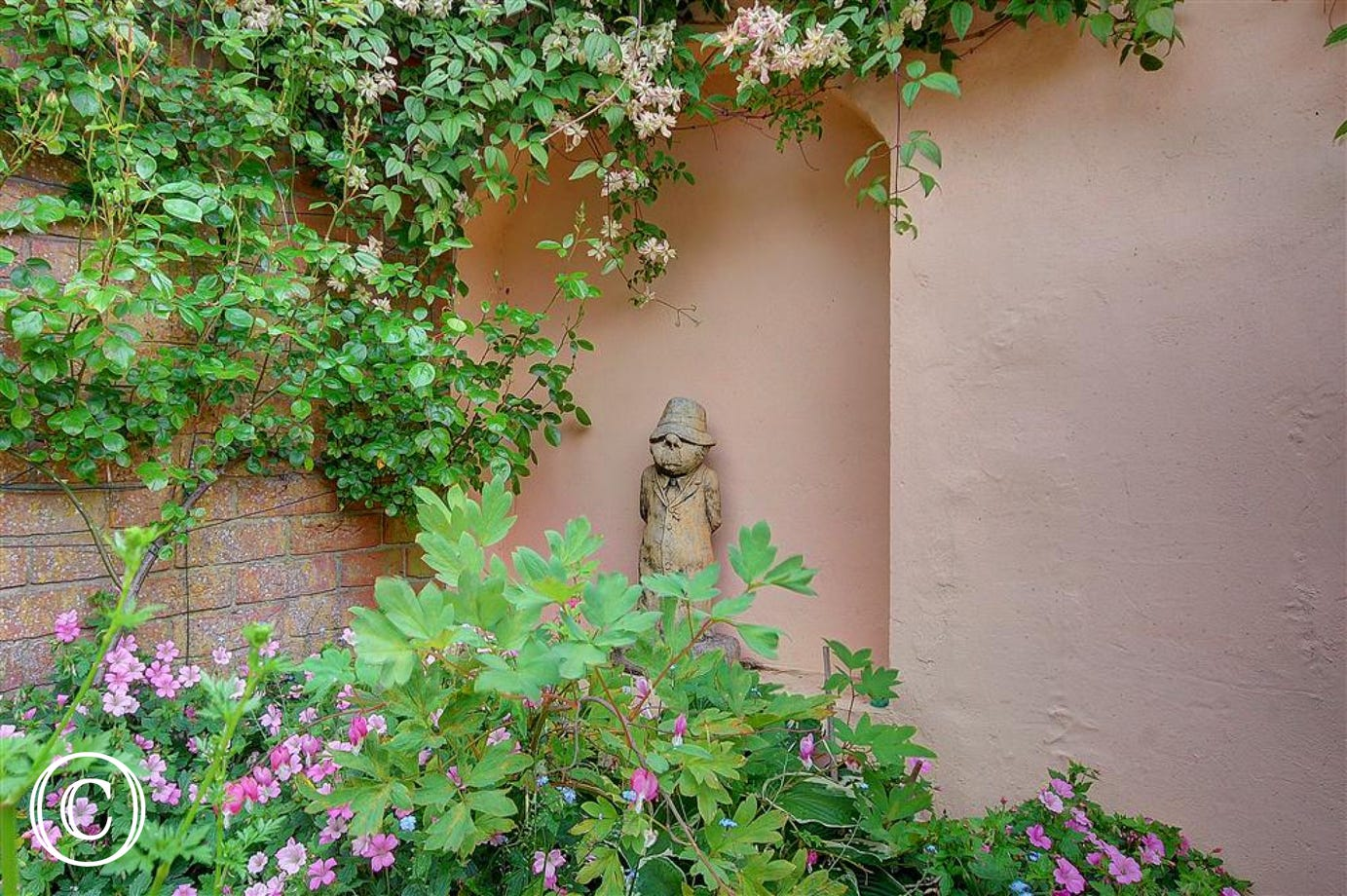 Enjoy this walled garden area that comes with the property.