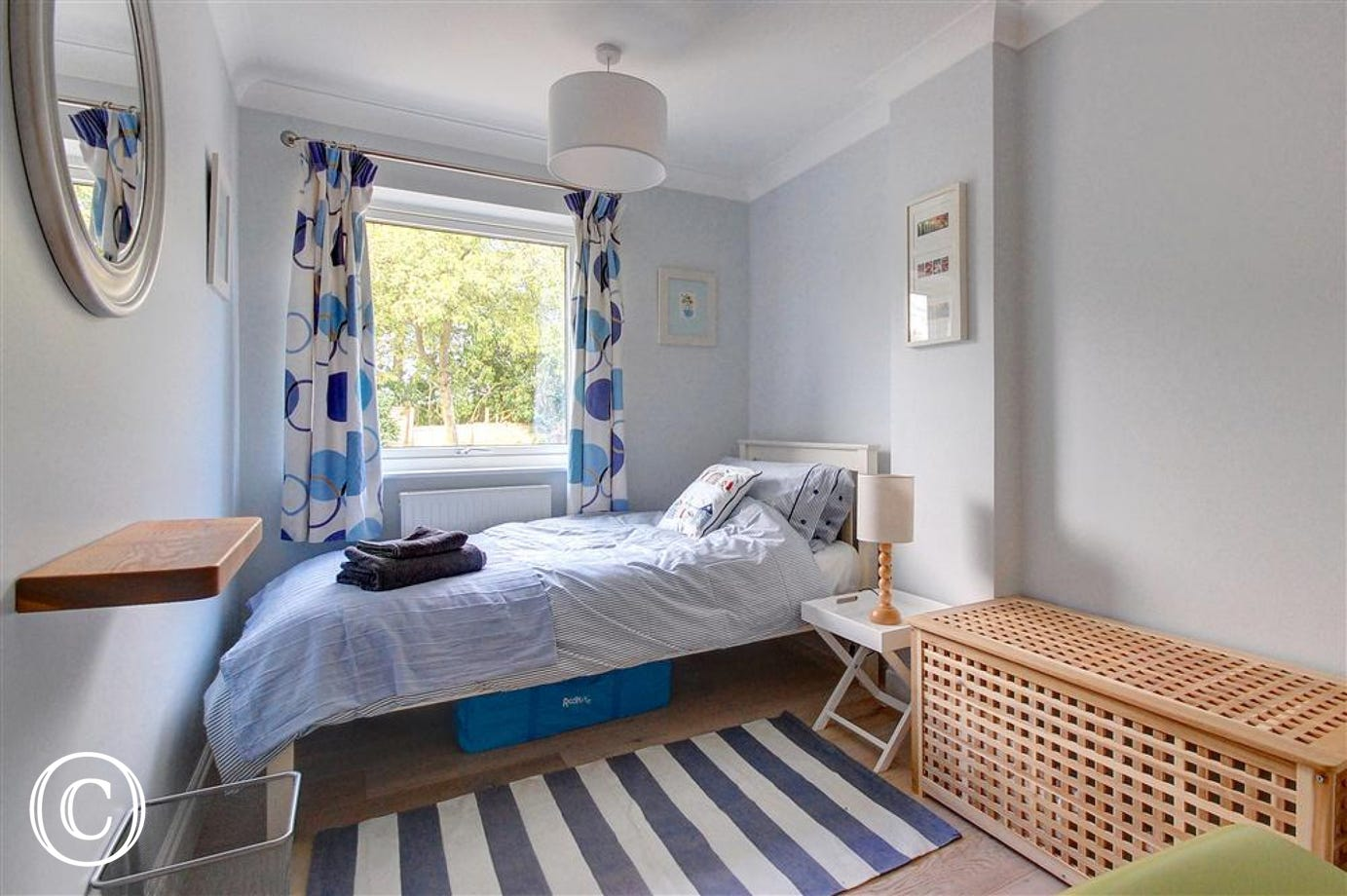 A stripy rug can be found in bedroom three which will sleep one person.