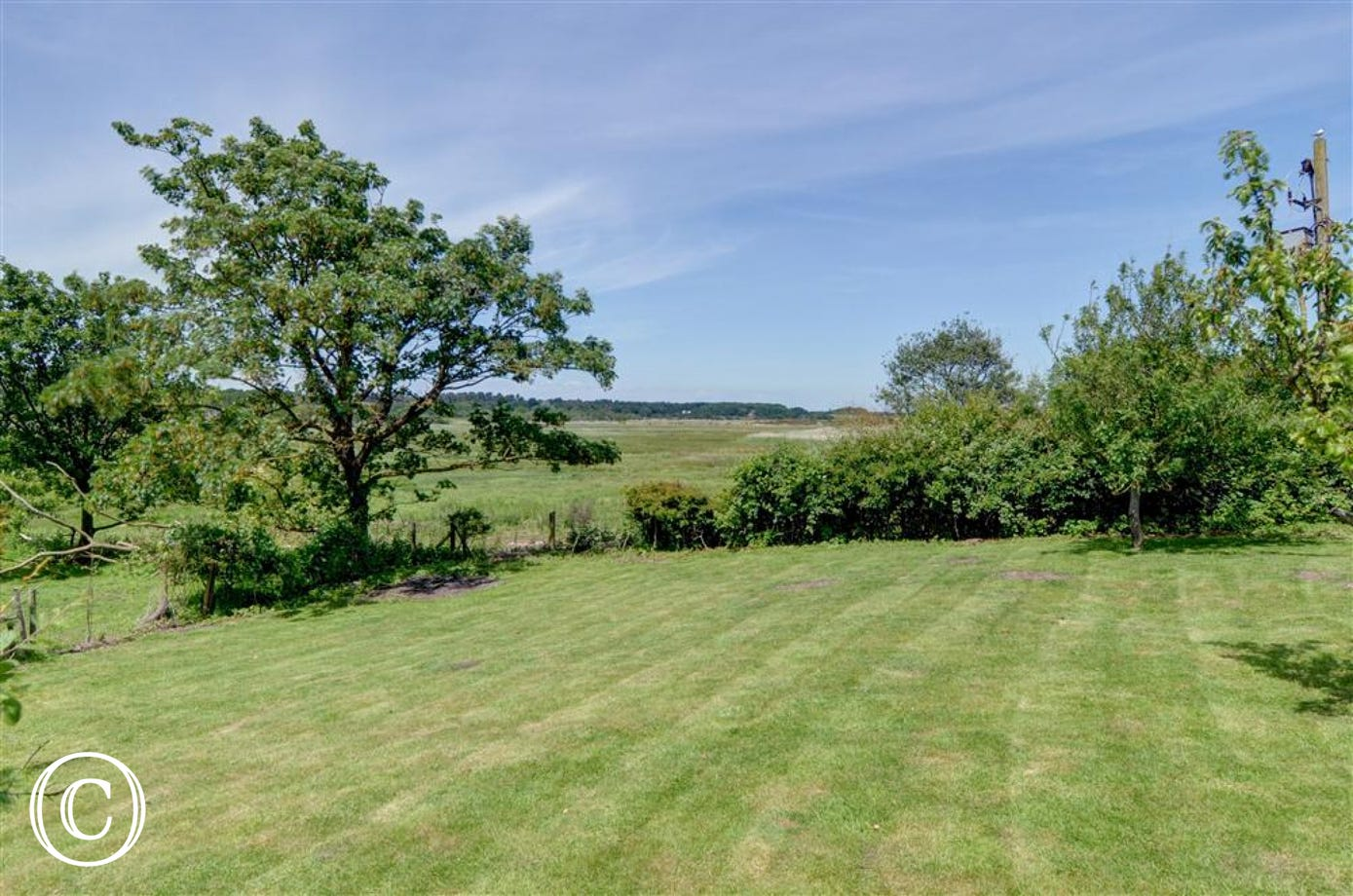 Enjoy the generous garden with lawn, tress and far off views.