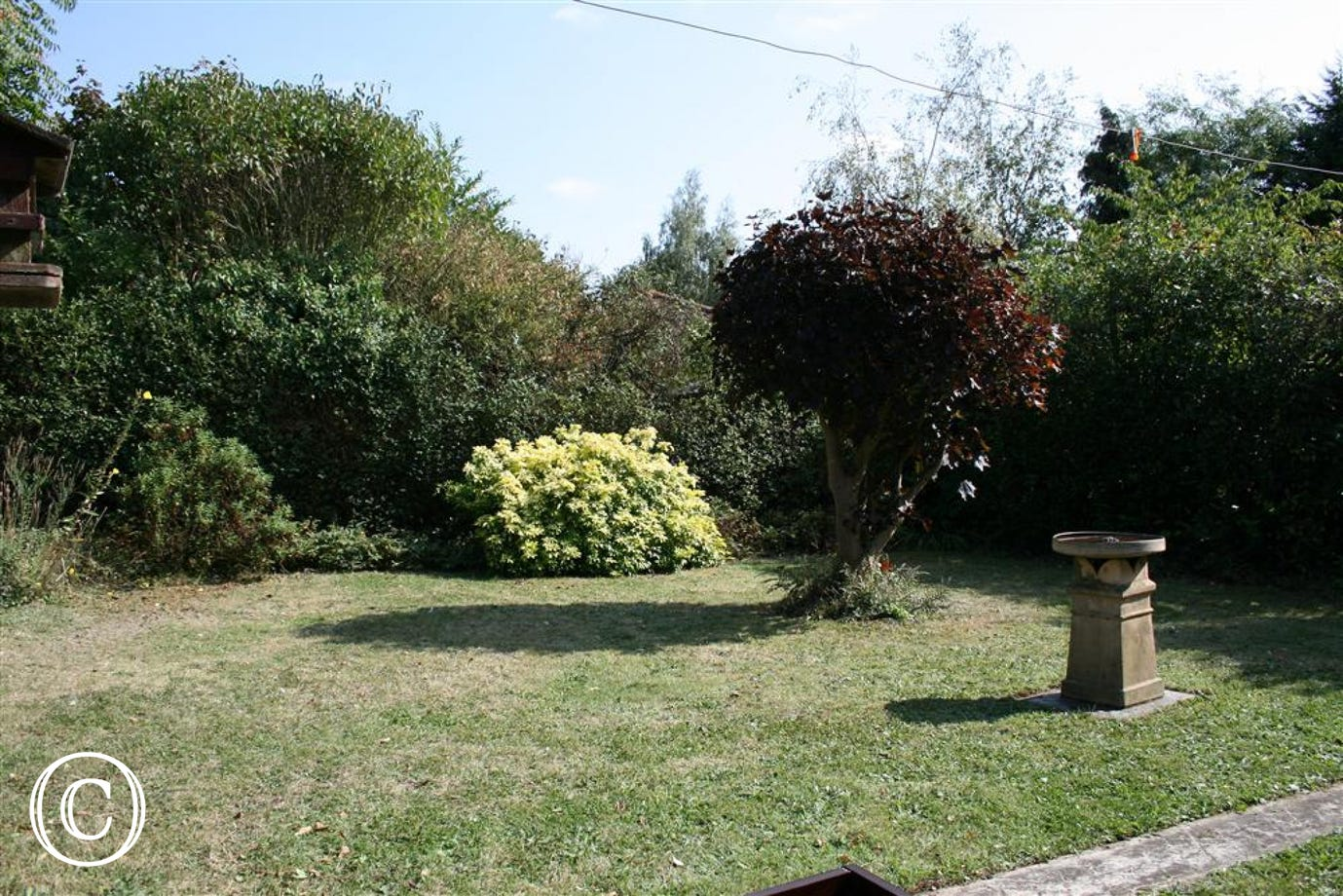 Relax in this garden area in the summer sunshine.