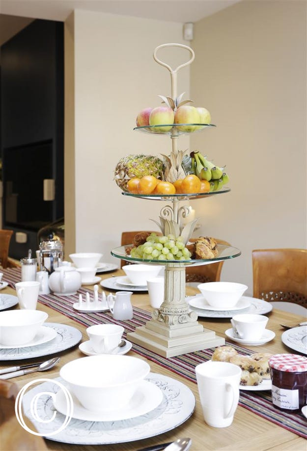 Dining Table with Fruit Tier Centrepiece