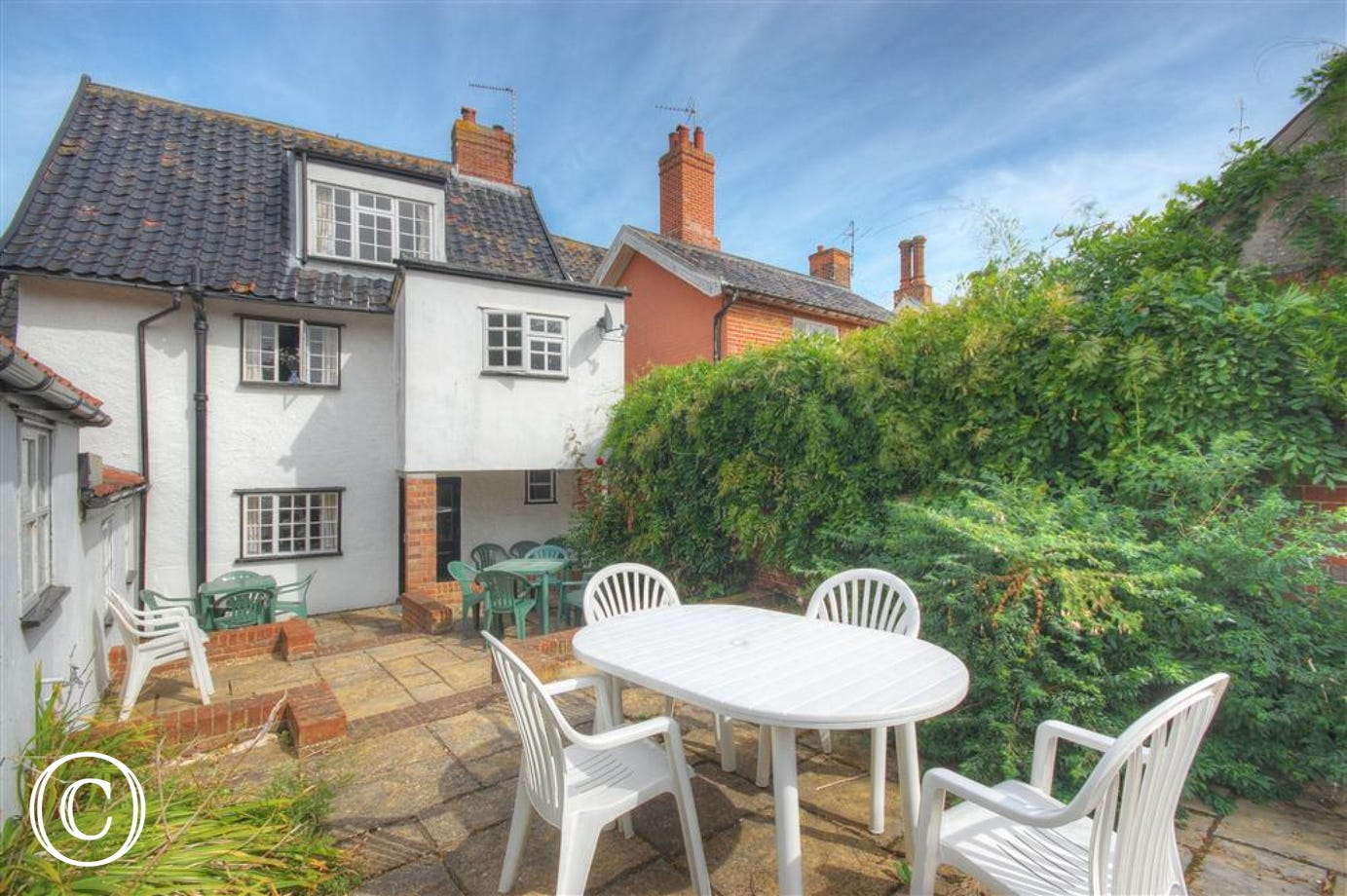 Enjoy the outside space this property has to offer and make use of the white garden furniture.