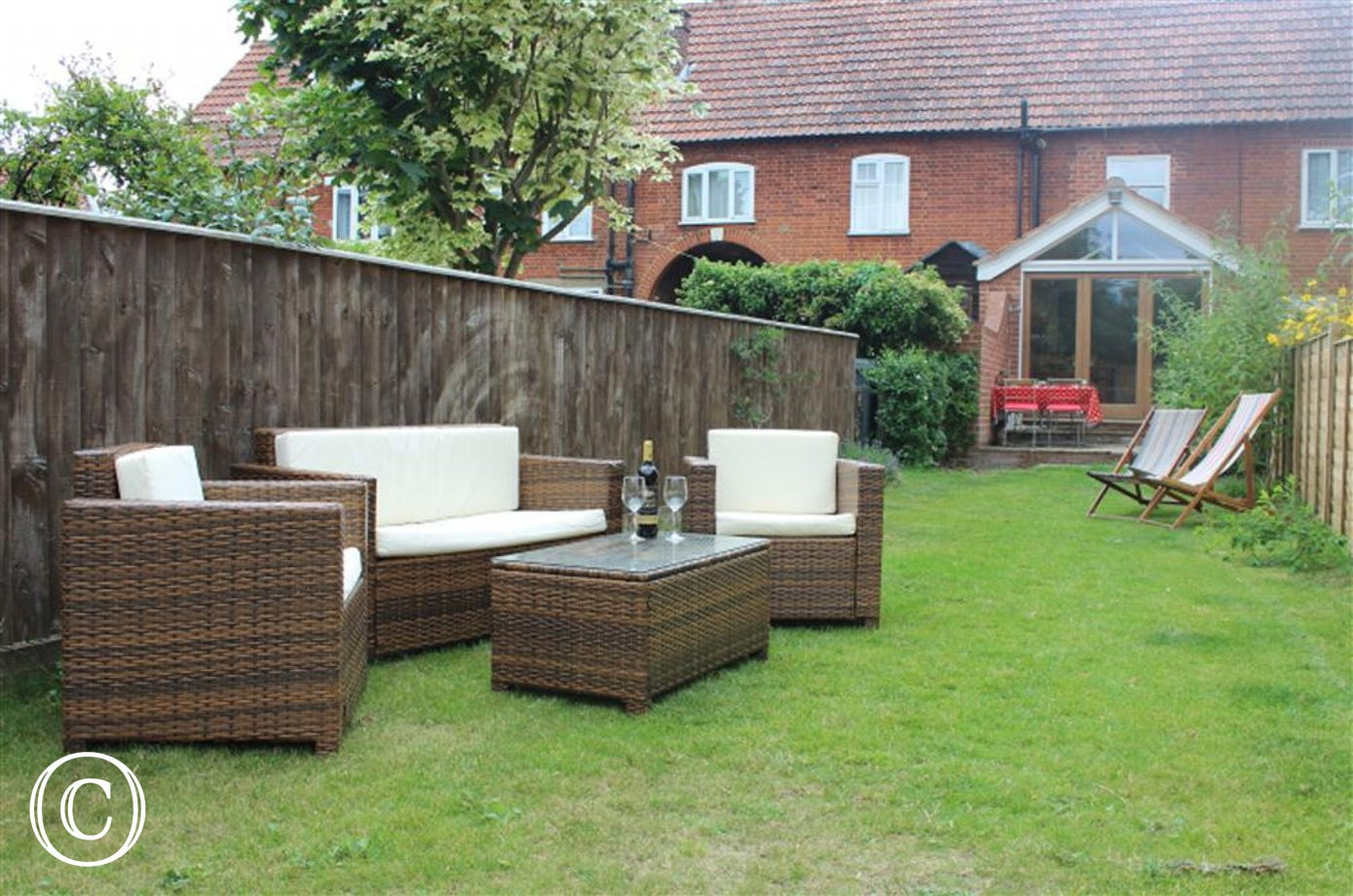 Use this ratton furniture to enjoy the outside garden space at The Fishermans Rest.
