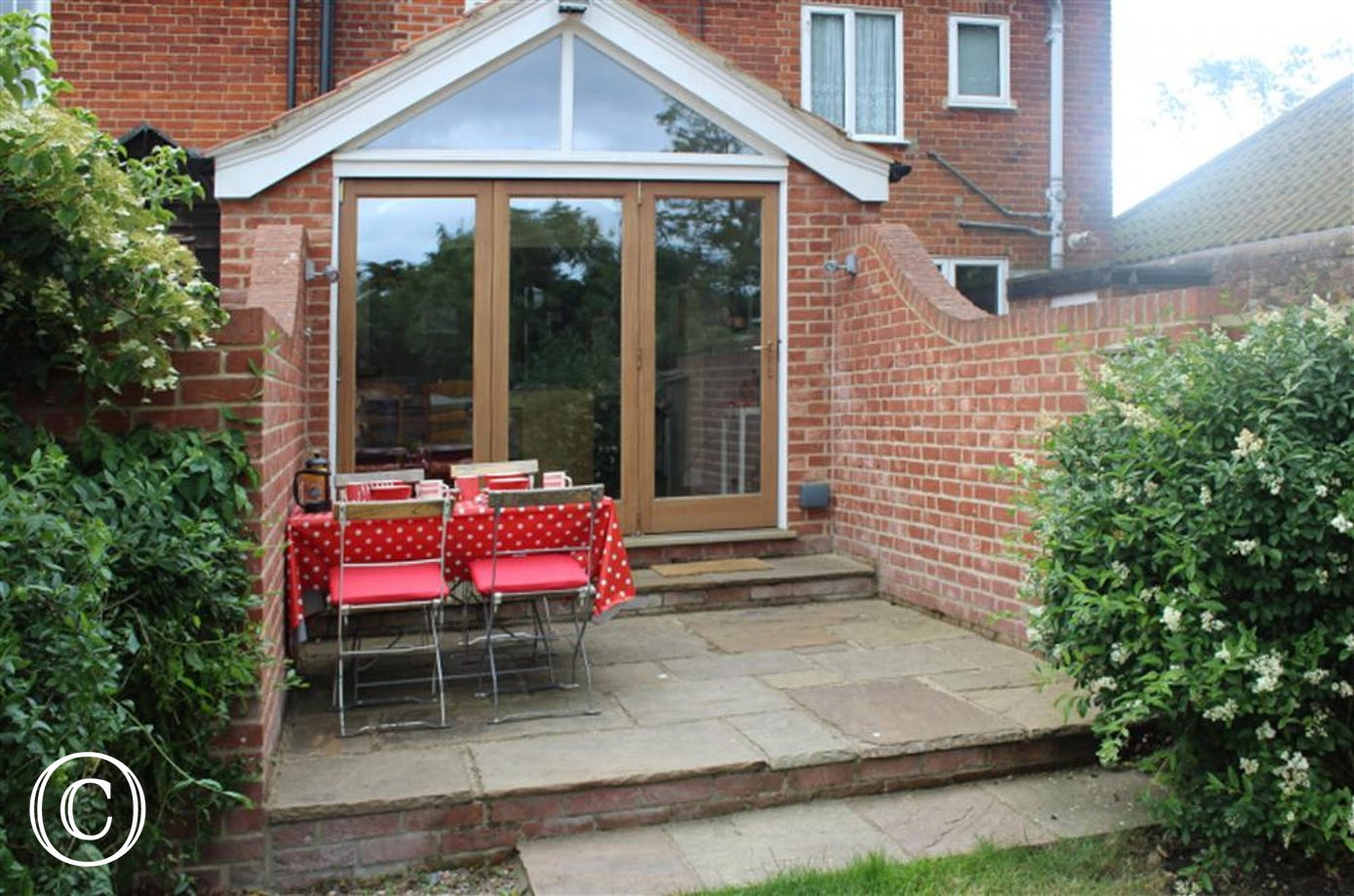 This patio area outside the kitchen makes for a great space to enjoy the tables and chairs provided and have a few alfresco meals