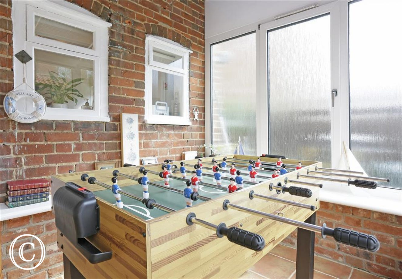 In the conservatory area is a great games table suitable for a competitive game or two.