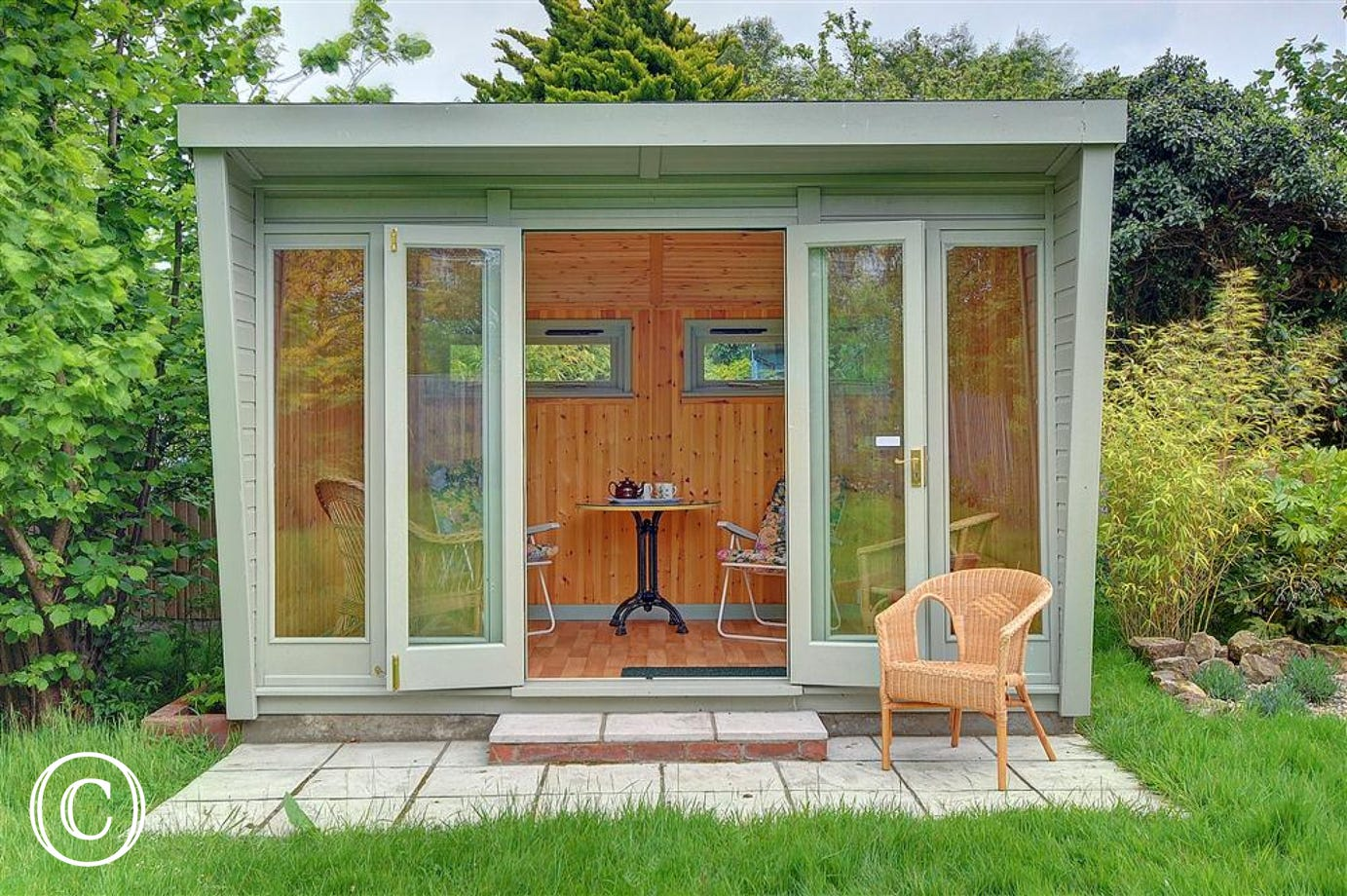 This modern summerhouse is situated down the left hand side of the rear lawned garden at Wolsey Cottage.