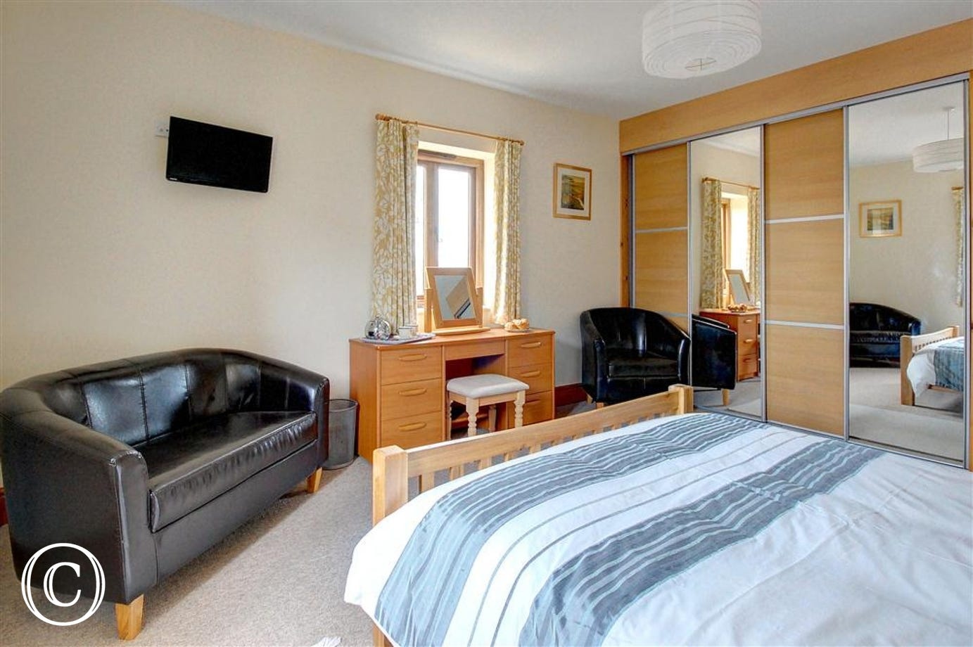 Take it at ease and enjoy some television in bed in this double bedded room.