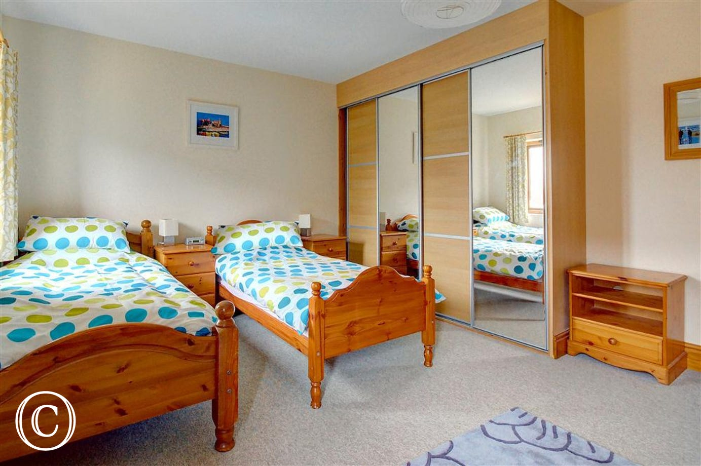 This twin bedded room with sliding wardrobe makes for easy unpacking when you get to the property.