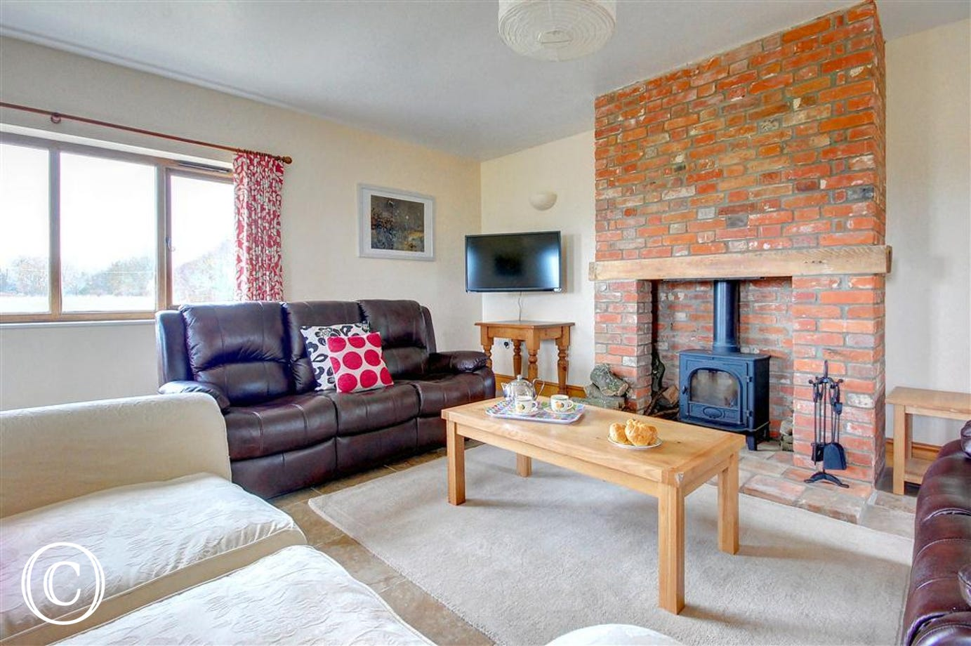 Gather around the wood burner in the sitting area and with three sofas for the four of you to choose from you won't miss out on those warming flames.