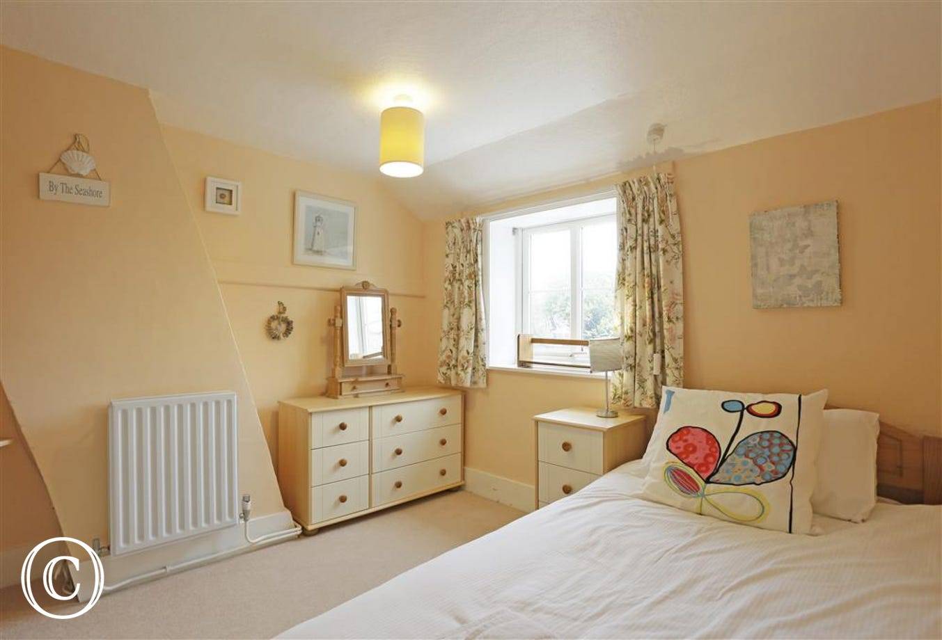 This single bedded room at the rear of the property is cosy and welcoming.