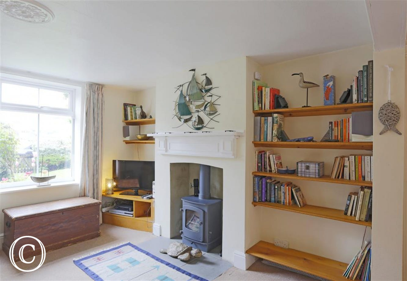 This neutral coloured sitting room has plenty of books for all ages.
