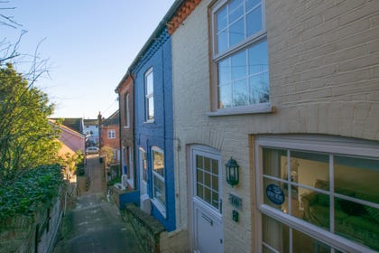 There is a short walk down hill down these steps from the front of the property allowing you convenient as quick access to the High Street.
