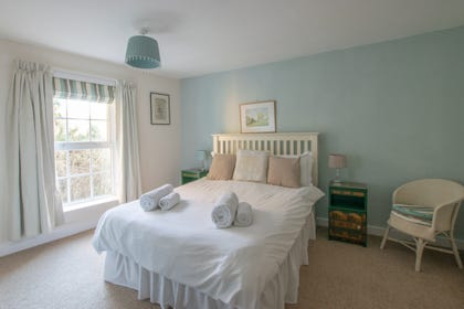 This spacious double bedroom is situated on the first floor at the front of the property and provides a relaxing neutral space.