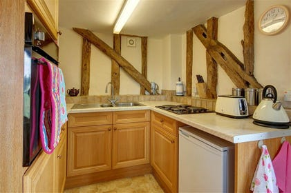 A cute cottage kitchen with all the equipment you should need for your self-catering holiday.