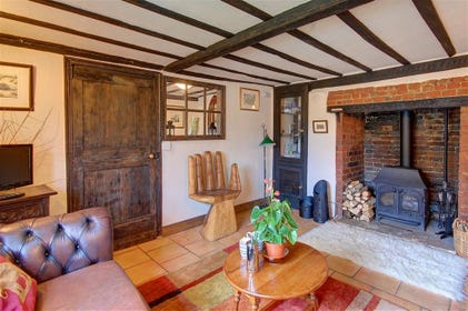 Get the wood burner roaring on chillier evenings in this comfy sitting room.