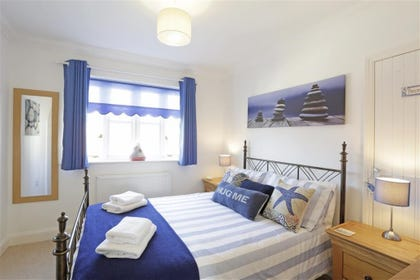 This cosy bedroom decorated in traditional sea-themed colours is the ideal haven to escape to after an adventure-packed day out by the sea.