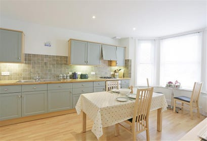 Open plan kitchen/dining room is appropriately furnished and has plenty of dining space.