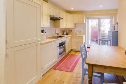 lovely light and aory kitchen with access to the patio area.