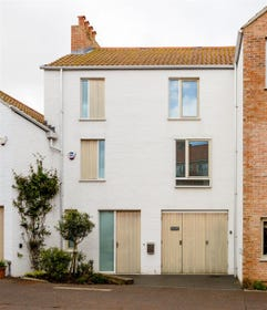 The exterior of swallows is a striking contemporary design referencing mews style houses .