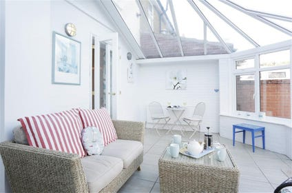 Bright and warm in the summertime, whether it be a cup of tea or a glass of wine enjoy some time in this sunny conservatory.