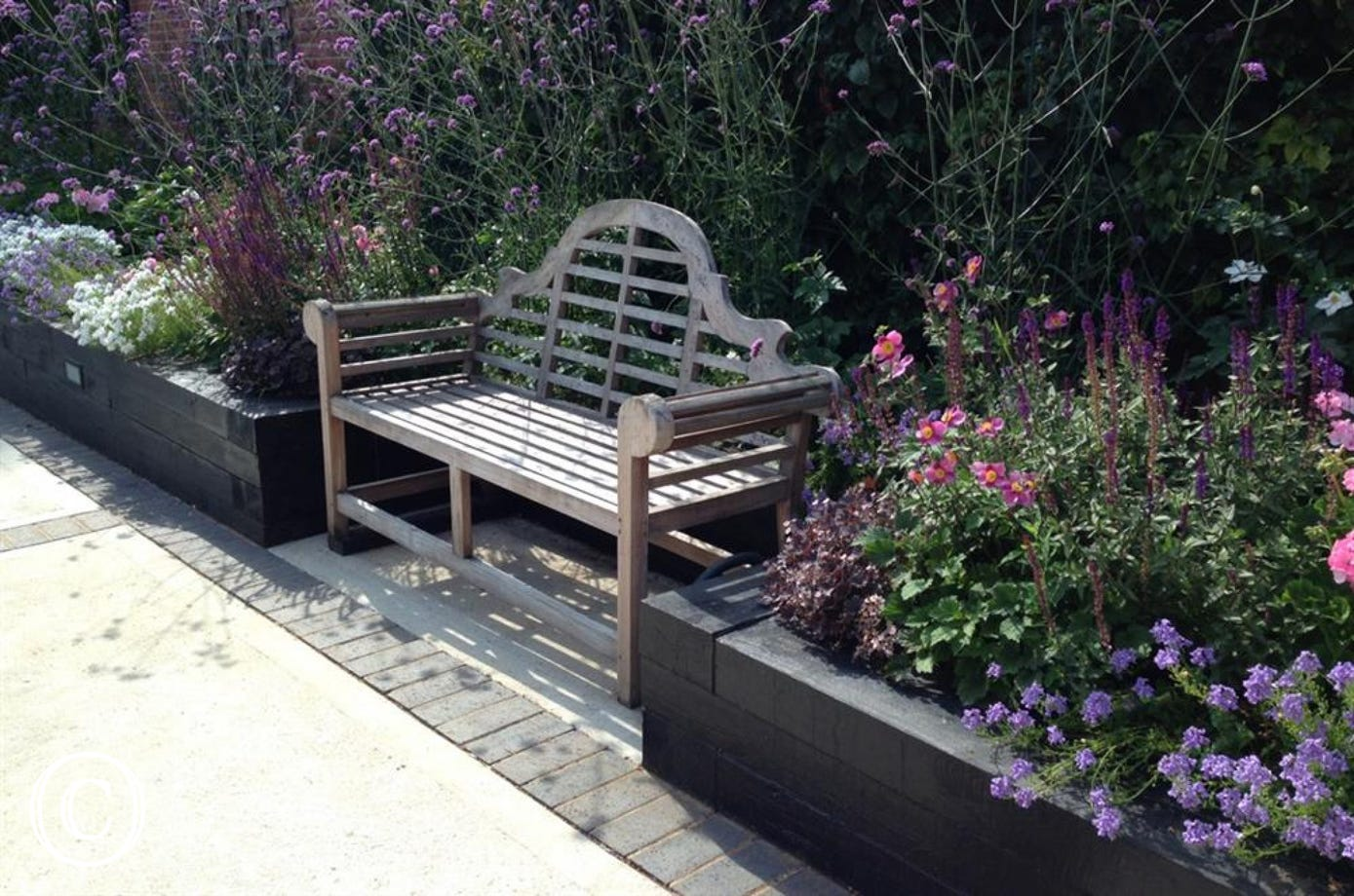 This rustic bench will provide a nice place to sit especially in summer when all the bulbs are out.
