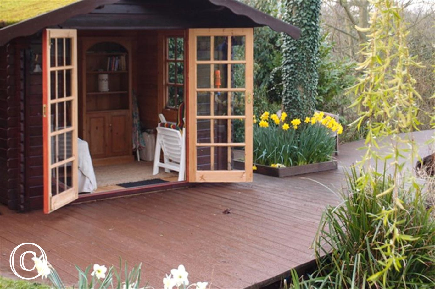 Enjoy this Summer House within the accessible grounds of the property.