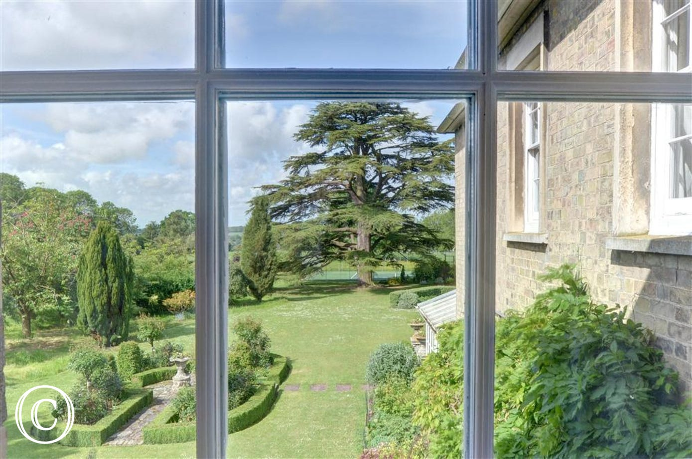 Enjoy the view of the gardens from this bedroom window.