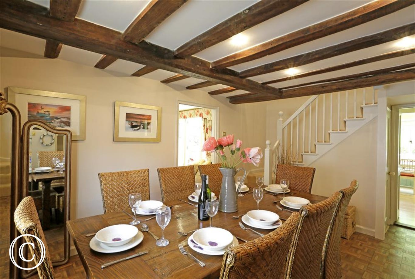 This dining area is centrally located for the kitchen and makes for a good place for you all to gather before you set off for the day.